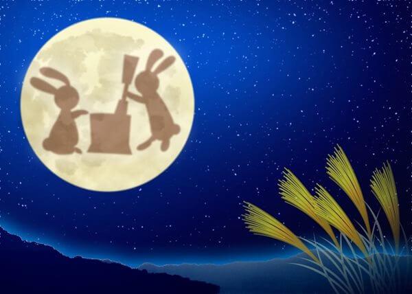 十五夜のお月様と餅つきしているうさぎ